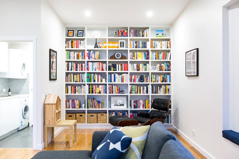 organized room with organized books on the shelf